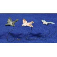Paloma volando 15 cm barro pintado