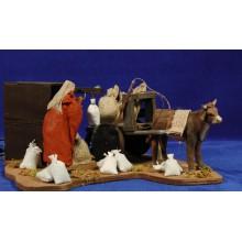 Pastor cargando carro movimiento  12 cm ropa y barro