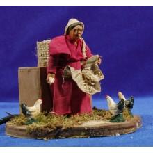 Pastora con gallinas movimiento 10 cm ropa y barro
