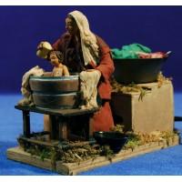 Pastora limpiando niño movimiento 12 cm ropa y barro