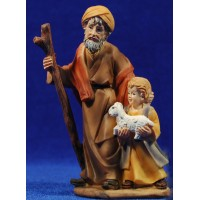 Pastor viejo con niño y cordero pequeño en brazos 11 cm resina