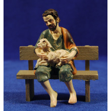 Pastor sentado en un banco con cordero 11 cm resina